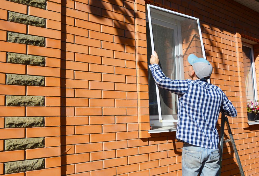 Window screen being installed
