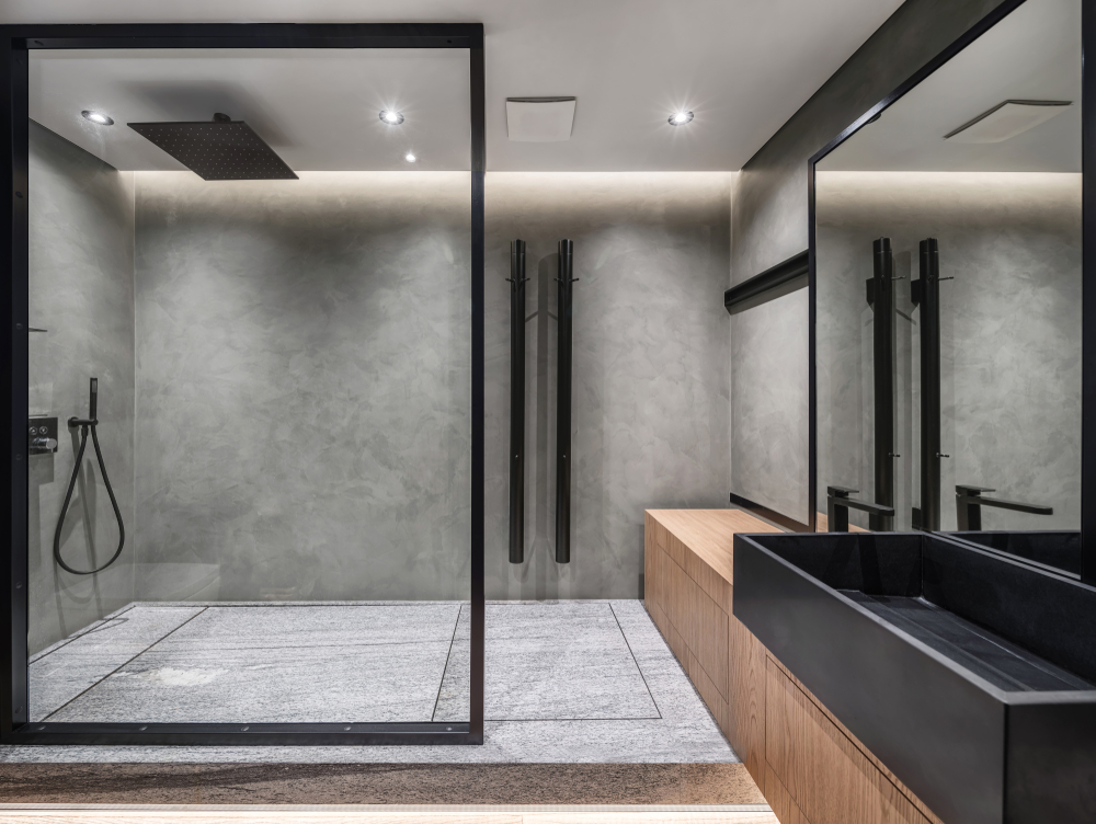 Glass shower doors that are framed with black-painted steel