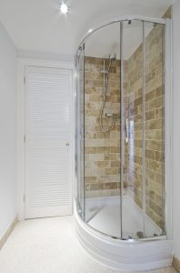 A small rounded glass shower