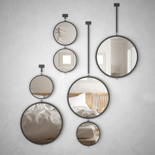 Custom round mirrors installed in a bedroom