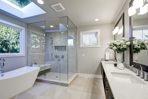 The interior of a bathroom with a glass shower door