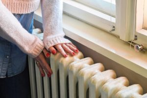 A radiator that is next to a closed window
