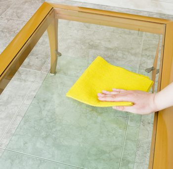 An image of a man cleaning a table