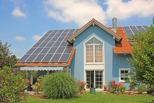 a home with solar panels and ecofriendly windows